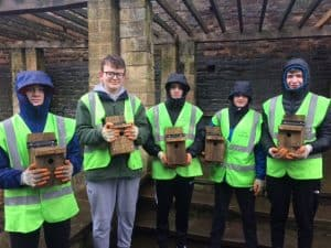 Picture of Finn, Cam, Owen, Shea and Alex holding bird boxes